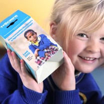 NO REPRO FEE 17/2/2015 A day of firsts: Athlone children recieve their very first Trocaire boxes as the charity launches its Lenten Campaign and new Trocaire box app. Junior infant five-year-old Laura Kennedy from Tubberclare National School, Glasson, Athlone is pictured today receiving her very first Trocaire boxes at the launch of Trocaire's Lenten Campaign. For the first time, a new Trocaire box app is also available to download free on IOS and Android. The Trocaire Lenten Campaign begins on Ash Wednesday, 18 February and runs to Easter Sunday, 5 April. To support Trocaire this Lent, visit trocaire.org, call 1850 408 408, pick up a Trocaire box from a local parish or download the new Trocaire box app free on IOS and Android. Photo: Mark Stedman/Photocall Ireland