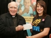 At the launch of the Robe Pastoral Area SERVE Philippines Projest pictured was Fr John Fallon making a presnetation  of a 1,000euro  cheque on behalf of Archbishop Michael Neary, to Grace Sheridan, represneting the SERVE Volunteers.               Pic:Trish Forde.