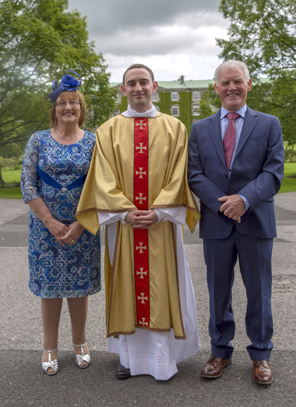 Deacon Shane Costello and his parents